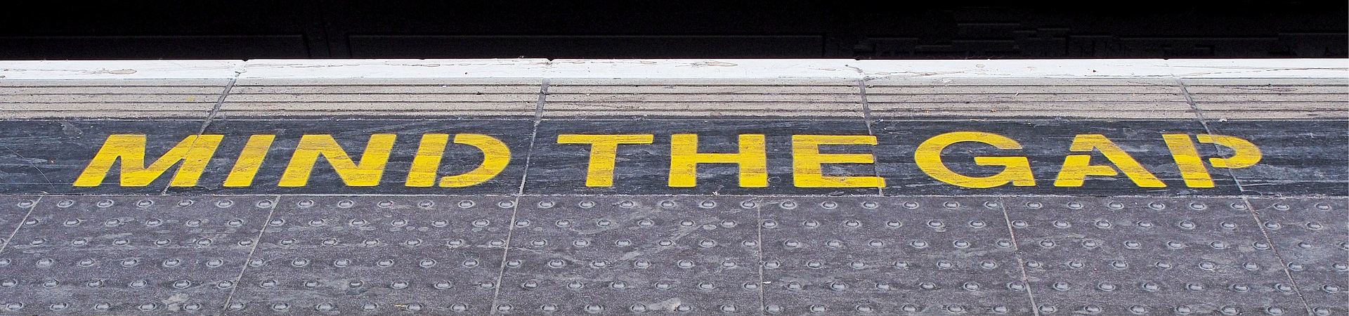 'Mind the gap' painted on the floor of the London Underground