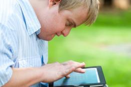 Picture of a disabled man using an ipad