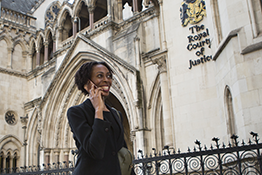 Woman talking on a mobile phone outside the Royal Court of Justice