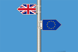 Signpost with the Union Flag pointing left and the European Union flag pointing right