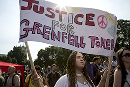 Protests for the Grenfell Tower fire, led by a woman with a large banner saying 'Justice for Grenfell Tower'