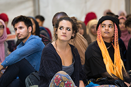 A group of people listening at an event