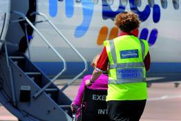 Wheelchair user being helped on-board an aircraft