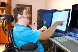 Picture of a disabled man using assisted technology