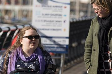 two women talking on a pier