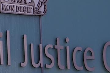 Sign outside Manchester Civil Justice Centre