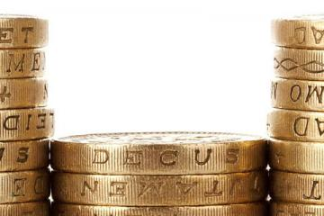 Seven stacks of pound coins at different heights