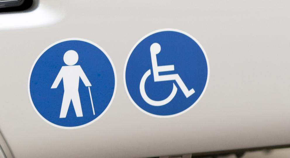 Disabled signs on the front of a bus