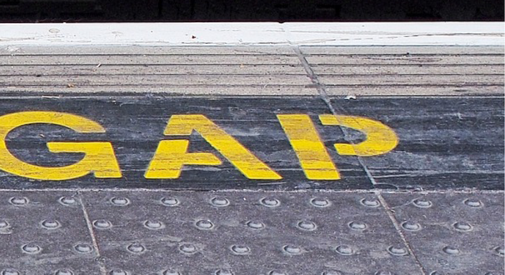 'Mind the gap' painted on the floor at a London Underground station