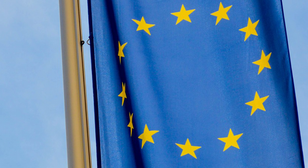 European Union flag hangs on a flag pole