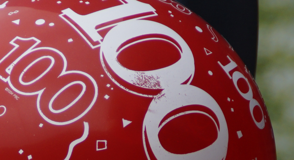 Balloons with '100' printed on