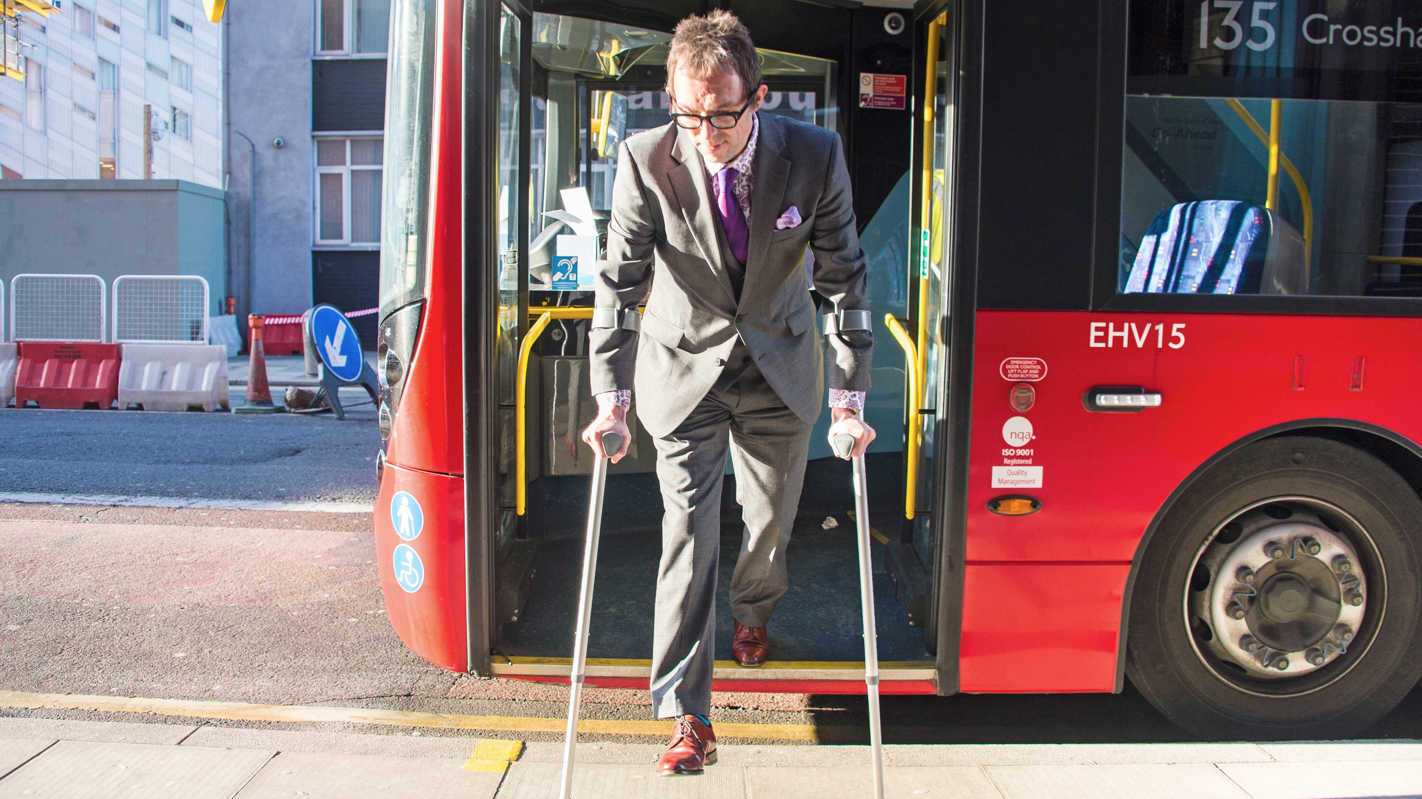 Passenger exits bus